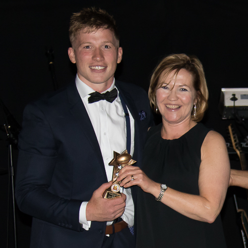 1stXV Player of the Season Joe Bercis receives his award from Cathy Lawler, regional sales manager for Haines Watts