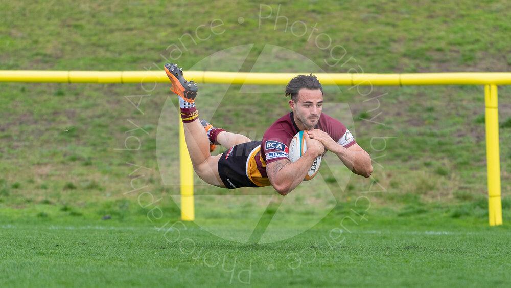 Sam Baker flies to a brace of tries